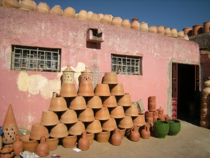 pots and pink wall